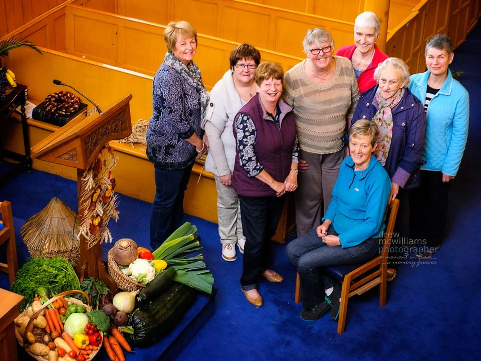 Members of the congregation at Dromore Non-Subscribing Presbyterian Church decorate the church for Harvest