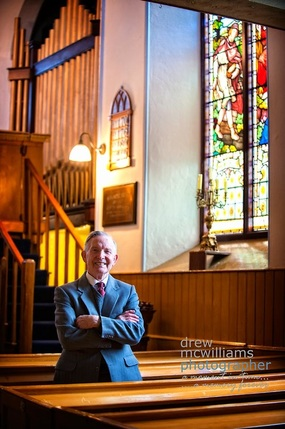Ernie Martin relaxes in the pews at Dromore Non-subscribing Presbyterian Church