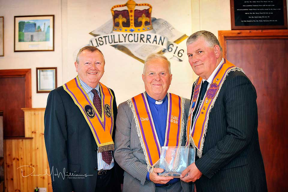 Listullycurran Truth Defenders LOL616 made a special presentation to Bro. Rev Sam J Peden to mark his term as Moderator of the Non Subscribing Presbyterian Church of Ireland. Included are Drew Nelson (Grand Secretary of the Grand Orange Lodge of Ireland) and Gordon Mateer (Worshipful Master LOL 616). Photo: drewmcwilliams.com
