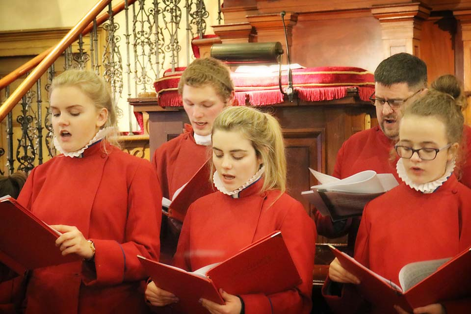 Members of the St Anne's Cathedral Girls' Choir singing in Banbridge Non-Subscribing Presbyterian Church